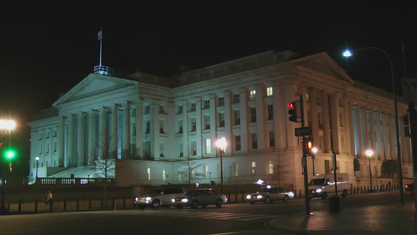 WASHINGTON, DC - CIRCA 2012: Lone figure walking up steps at mid-clip. United States Treasury Department building is the oldest departmental building in DC, at  corner of 15th St and Pennsylvania Ave.