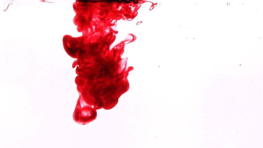 Red Ink Like Blood Dropped Into Water Slow Motion On