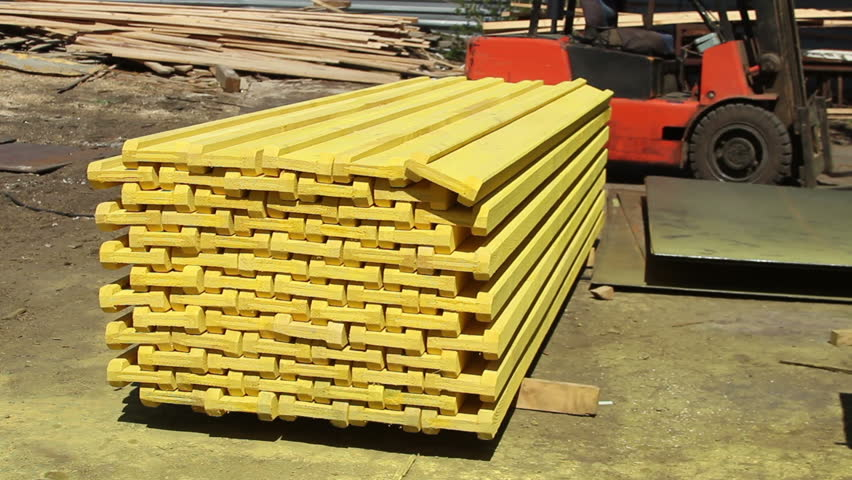 Wooden covering stack painted yellow for construction sites at sawmill factory