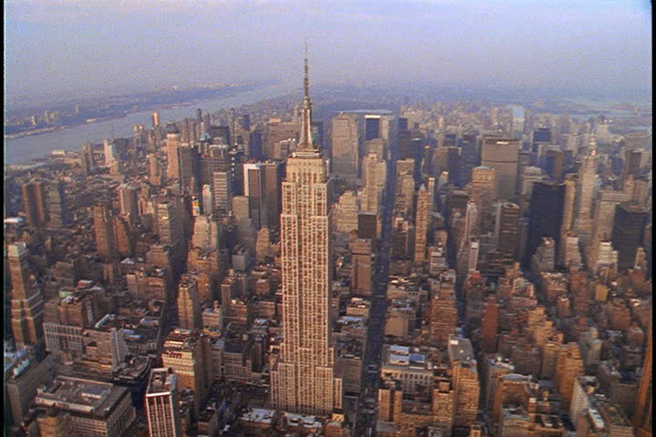 Aerial shot over Manhattan, slowly circling the Empire State Building in New York City, USA. | Shutterstock HD Video #4058998