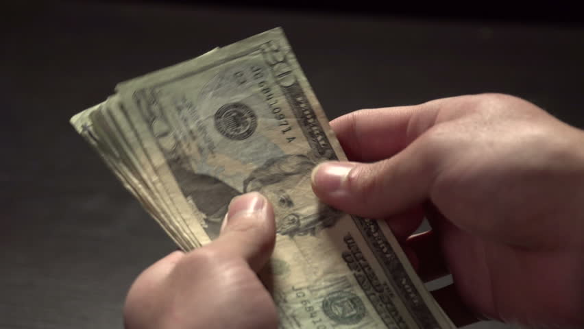 Counting money in slow motion