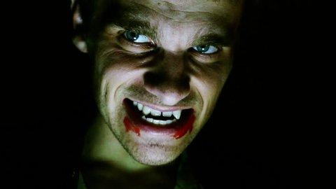 scary vampire looks at the camera