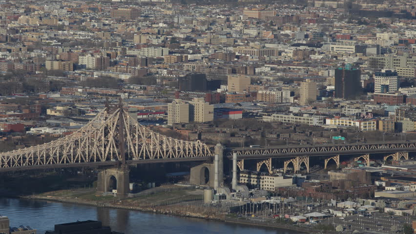 Aerial View of Queensboro Bridge, East River, Industrial Queens Skyline in New York City, NYC, USA