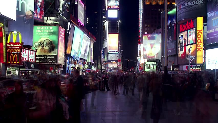 NEW YORK CITY - APRIL 21: Crowd at Times Square at night. Time lapse. April 21, 2012 in NYC, New York, USA.