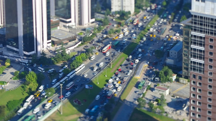 Aerial view to freeway with traffic jam in Istanbul, Turkey. Video with miniature fake effect using tilt&shift lens.