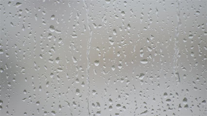 HD  rain water drops on the windows glass