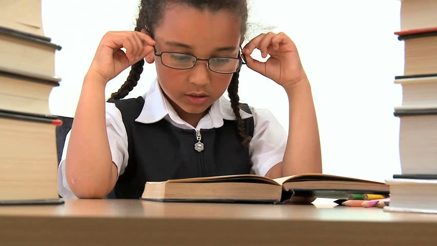 Cute african american schoolgirl early learning with reading books