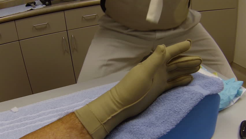 Stock Video Clip Of Doctor Putting Compression Bandage On