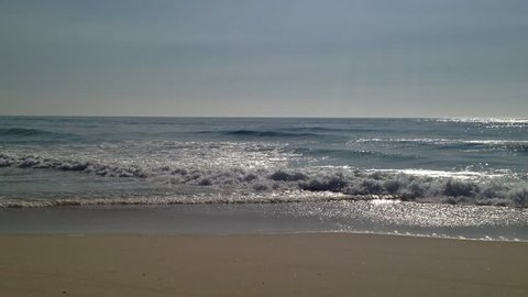 Ocean Waves and Beach: The waves from the sea of beach come rushing to the coast.