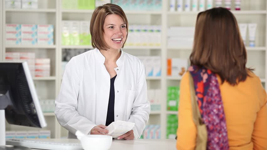 Female customer buying medicine at the pharmacy