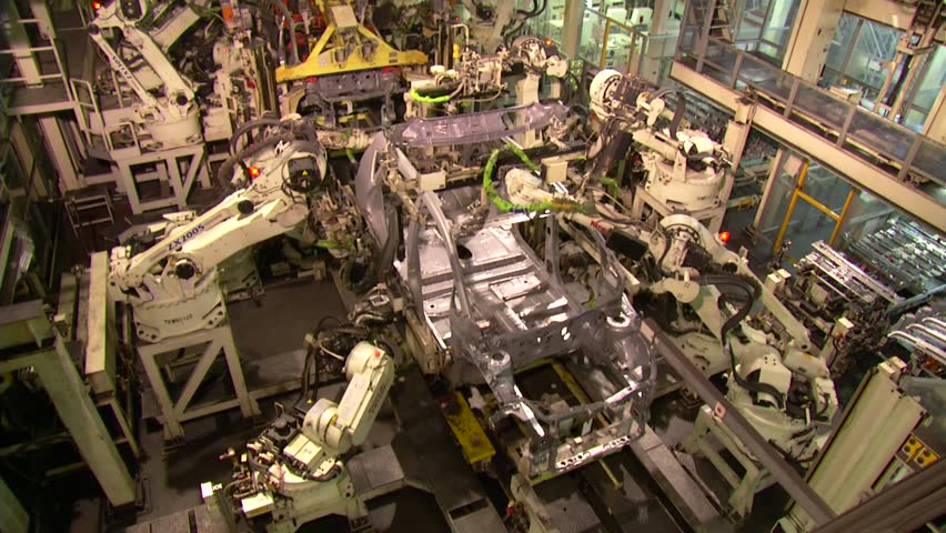 Robots are welding in automobile factory. assemble a car in fast motion.  | Shutterstock HD Video #4203268