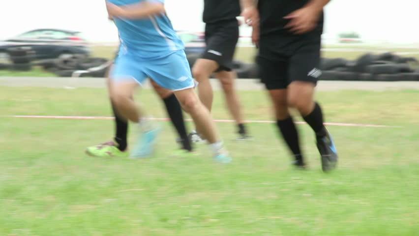 Street summer soccer football on grass, attacking team shoots on goal