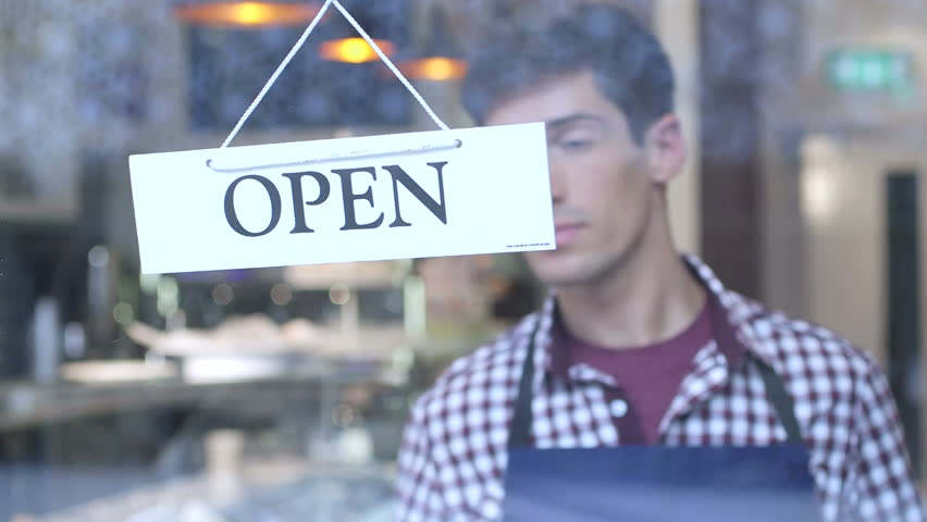 Man flipping over cafe open sign | Shutterstock HD Video #4219510