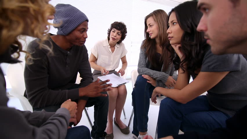 Patients of group therapy talking in circle