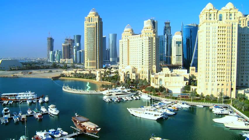 Aerial view Four Seasons Marina Doha luxury boats moored city skyscrapers Doha, Qatar, Persian Gulf