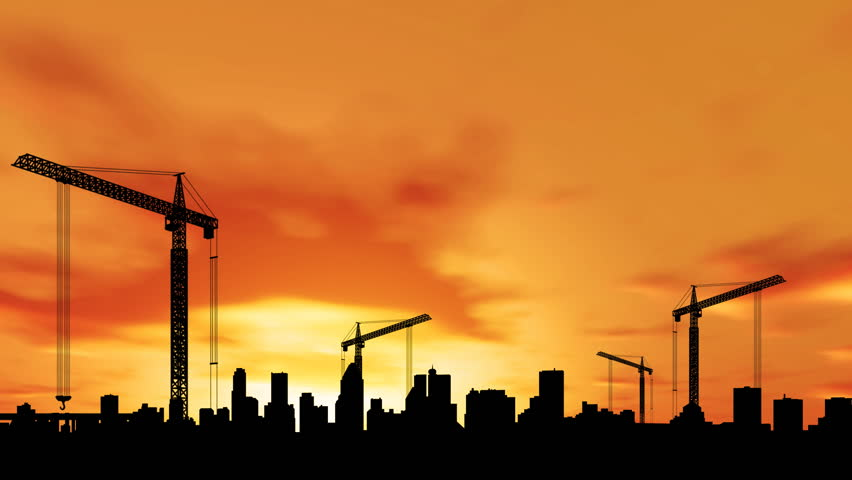 Time lapse of construction at sunset with city in the background