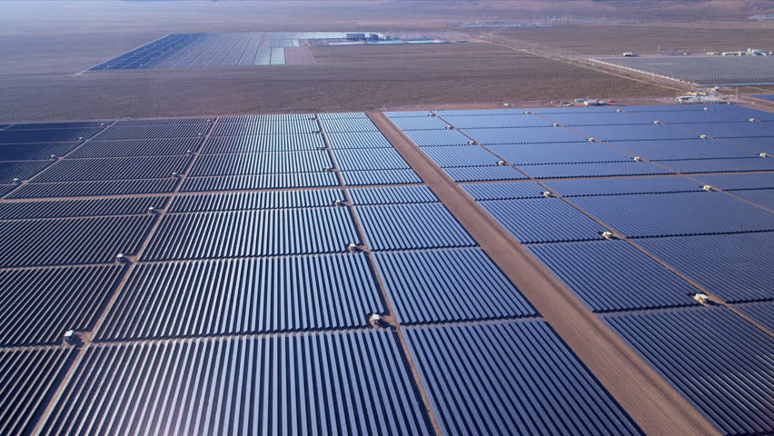 Aerial desert view large industrial Solar Energy Farm producing concentrated solar power, USA