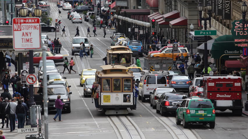 SAN FRANCISCO, USA - APRIL 3, 2013 San Francisco Tram Trip in a Trolley Cable Car, Fisherman's Wharf, Busy Commuters and Tourists