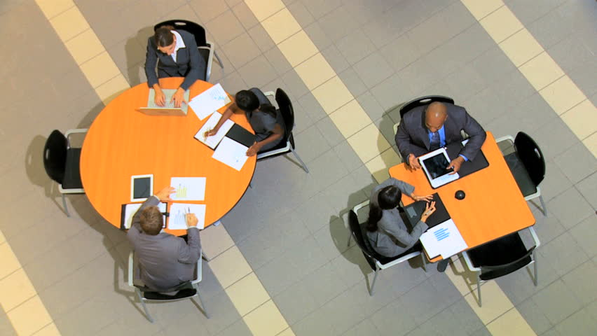 Overhead view of groups of multi ethnic business people holding meetings | Shutterstock HD Video #4286408