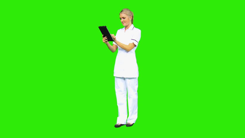 Female Caucasian nurse using wireless tablet key pad green screen virtual medical environment