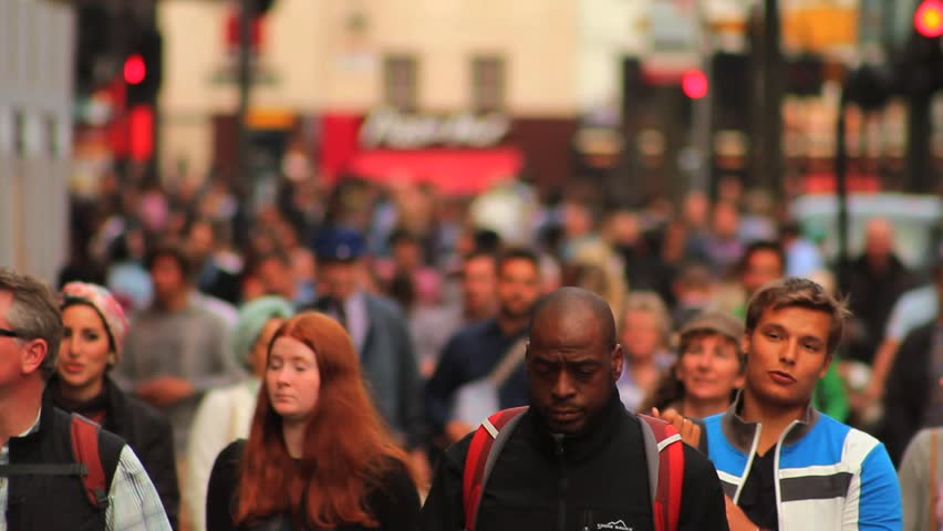 LONDON - July 3: Crowd of People / Commuters on Busy London Street on July 3 2013 in London England.