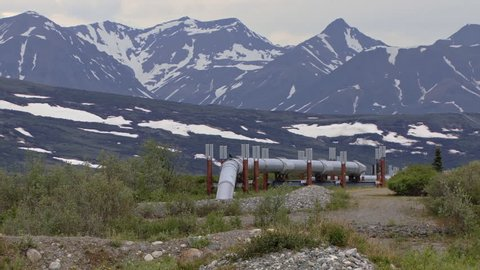 Pullback with Trans-Alaskan Pipeline in the foreground and Alaskan mountains in distance
