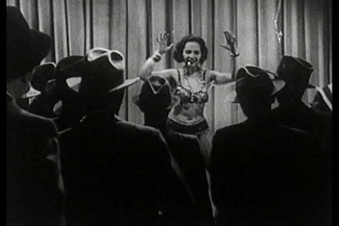 1930s - Carlotta the hot tamale from south of the border performs a striptease in this 1930s stag film.