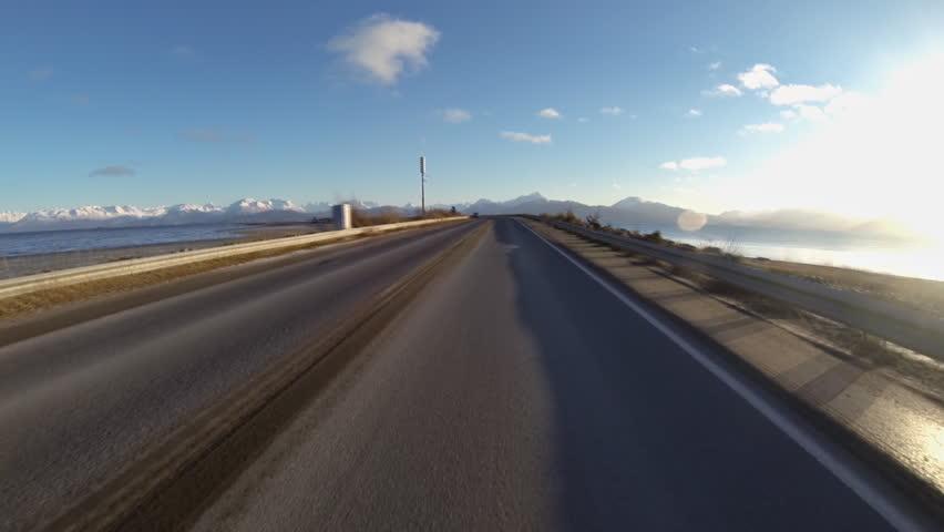 Driving POV on isolated Homer Spit Road, Homer, Alaska