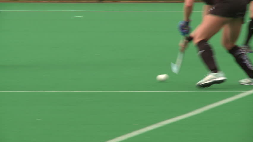 Field Hockey played on astro turf. woman's field hockey played on a rainy day in London. | Shutterstock Video #4320347