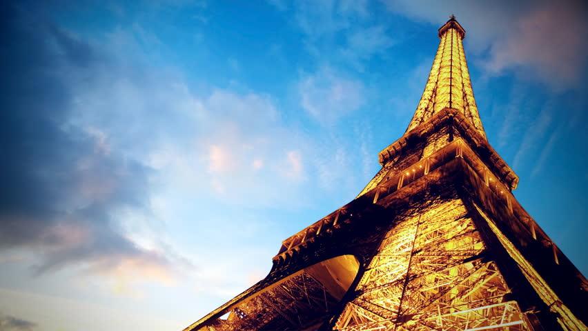 Timelapse view of Eiffel tower in Paris (PARIS - JUNE 24: Beautiful timelapse night view of the Eiffel tower in Paris on JUNE 24, 2009. )