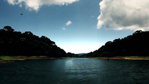 Tracking shot of a lake, Periyar Lake, Thekkady, Kerala, India