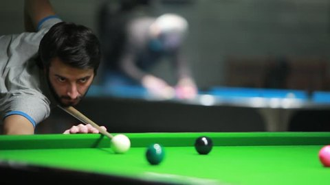 Young man playing billiard (snooker)/Snooker player
