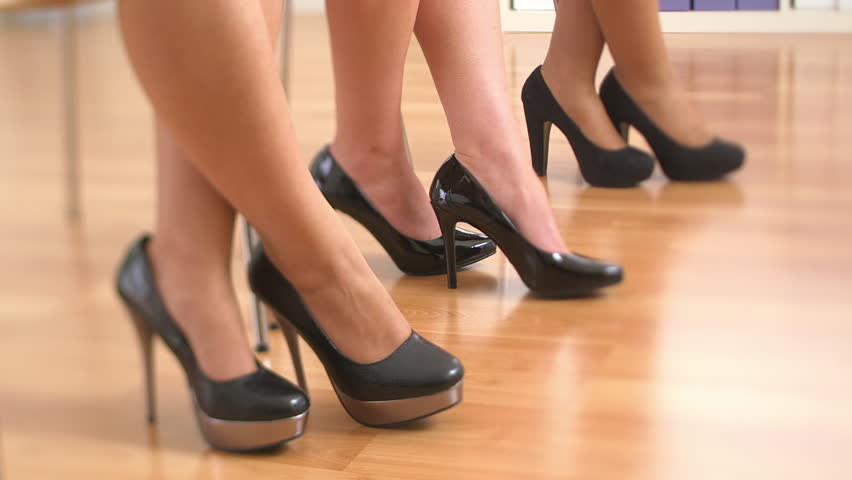 Close Up Of Three Business Women's Feet In High Heels Standing Up ...
