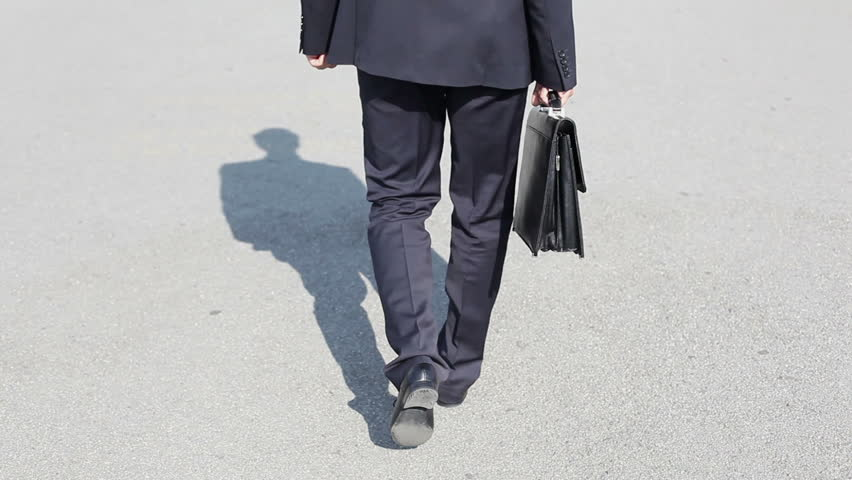 The rear view of a businessman being on his way to work | Shutterstock HD Video #4388408