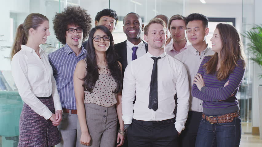 Portrait of a happy and casual young creative business team smiling and having fun together. In slow motion. | Shutterstock HD Video #4389008