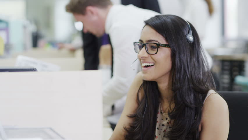 Cheerful young customer service operator, at work in a busy call center   Shutterstock HD Video #4390568