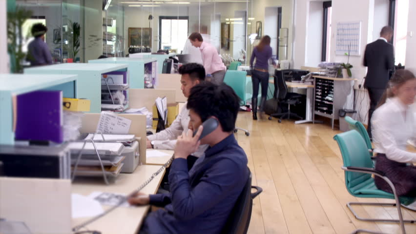 Row Of Call Center Operators At Work. Customer Services ...