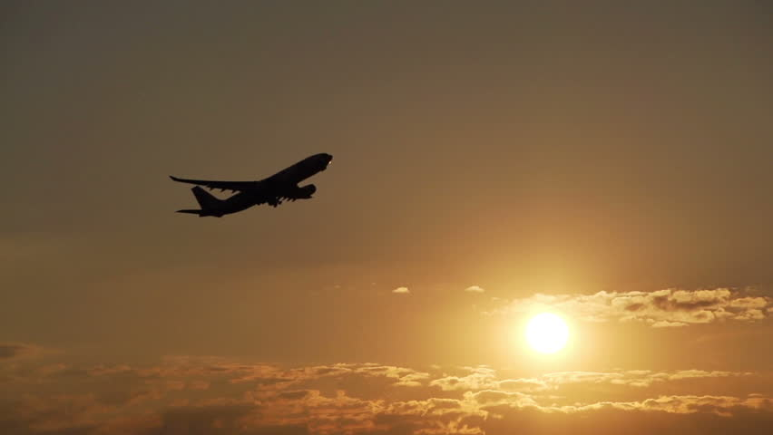 Airplane take off at sunset - HD stock video clip