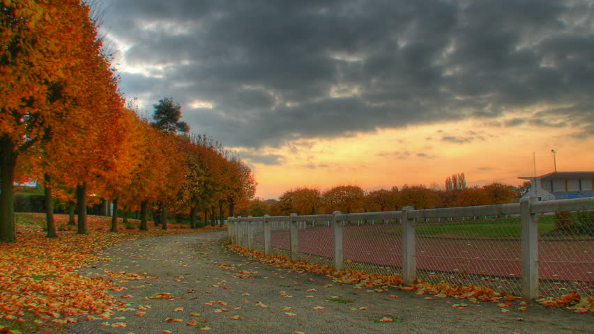 Autumn sunset over trees at stadium, HD motorized time lapse clip, high dynamic range imaging