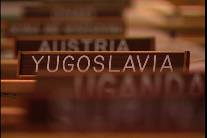NEW YORK CITY - FEBRUARY 11, 1999: MCU row of wooden name signs for countries Uganda, Yugoslavia and Austria in the United Nations General Assembly hall.