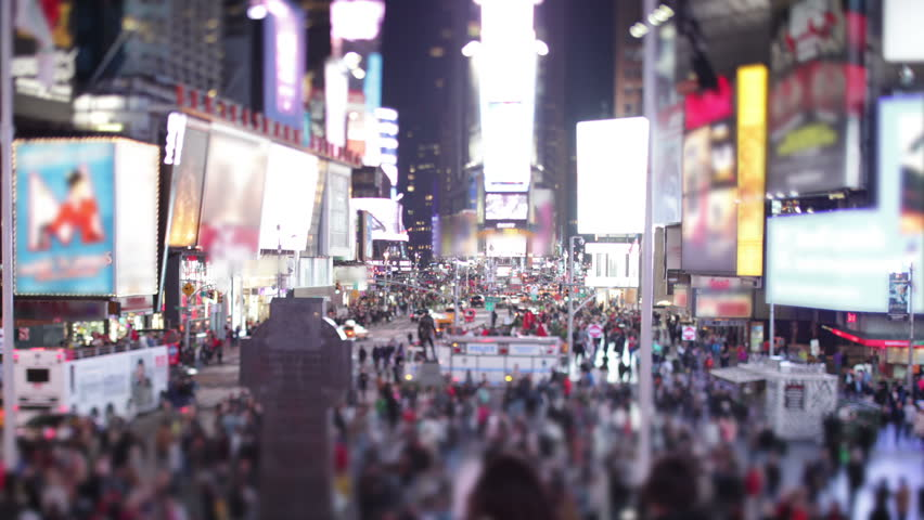 Time lapse of bustling crowds and traffic and the famous advertising billboards at Times Square, New York.