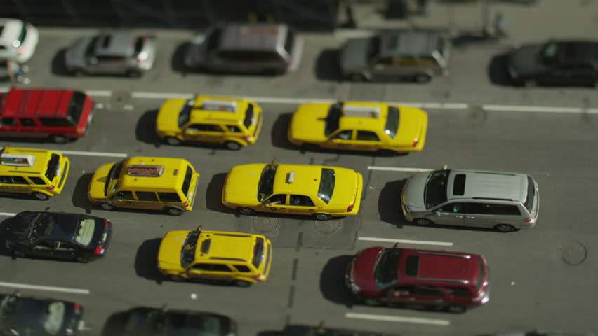 Overhead view of traffic at a standstill in a New York street on a bright morning. In slow motion.