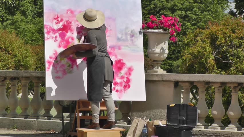 PARIS - SEPTEMBER 9: An artist painting in the Luxembourg Gardens (Jardin du Luxembourg), in Paris, on September 9, 2012. The park is the second largest public park in Paris.