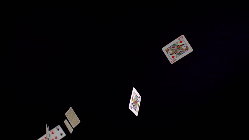 Playing cards falling on black background shooting with high speed camera, phantom flex.