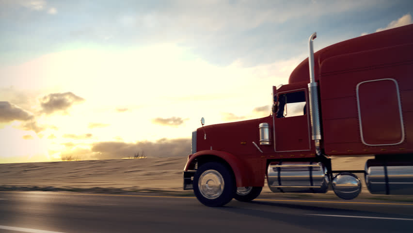 18 Wheel Truck on the road with sunset in the background. Large delivery truck is moving towards setting sun. Back side view.