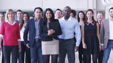 Portrait of young diverse business team at work. Large business organization in corporate building.