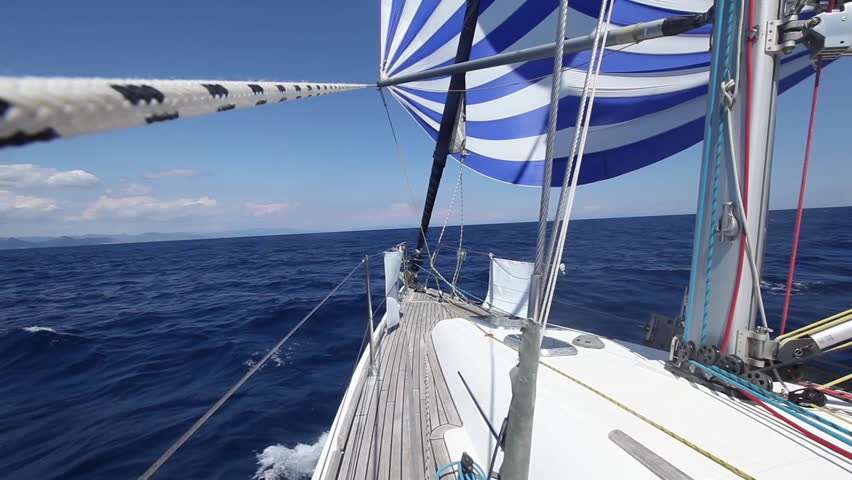 Sailing boat shot in full HD at the Mediteranean sea. Sailing in the wind through the waves (HD)