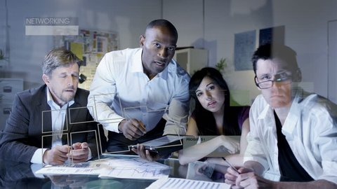 Business team working on futuristic touch screen with tablet remote interface.
