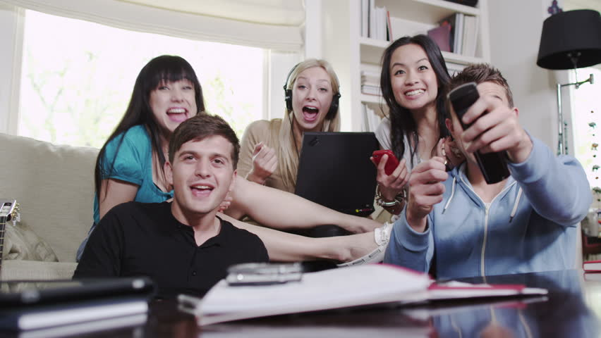 Young people with digital technology having fun. Student house accommodation. Flat share with teenagers or young adults | Shutterstock HD Video #4501187