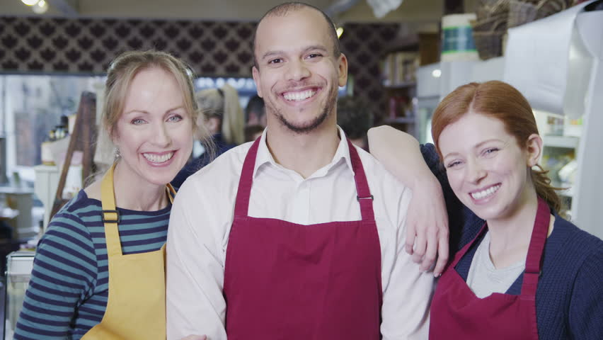 Portrait of happy male and female workers in a cafe or grocery store. | Shutterstock HD Video #4501958